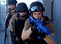 US Navy 070702-N-6710M-022 Members of the visit, board, search and seizure (VBSS) team aboard USS Tortuga (LSD 46) demonstrate the proper weapons tactics for a group of embarked midshipman.jpg