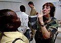 US Navy 070926-N-6278K-061 Air Force Tech. Sgt. Cynthia Sanders, an optometry technician attached to Military Sealift Command hospital ship USNS Comfort (T-AH 20), examines a patient's eyes at the Project Dawn at Lilienda.jpg