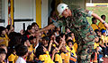 US Navy 071026-N-7367K-016 Senior Chief Builder E. Dan Walker, the senior enlisted leader of U.S. Naval Mobile Construction Battalion (NMCB) 1, Guam Det., reaches out to the students at Chief Brodie Memorial Elementary School i.jpg