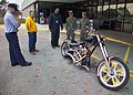 US Navy 080117-N-0857S-002 Personnel assigned to Naval Support Activity New Orleans look at the Marine Corps Tribute Bike on display outside the Navy Exchange.jpg