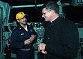 US Navy 080208-N-6403R-002 Archbishop Timothy Broglio, archbishop for the military services talks with Lt. Cmdr. Jason B. Nunez on the bridge of the amphibious assault ship USS IWO JIMA (LHD 7).jpg
