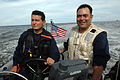 US Navy 080902-N-7544A-074 Chief Boatswain's Mate Daniel Chavez and a member of the Colombian Coast Guard drive a rigid inflatable boat.jpg