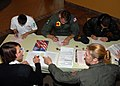 US Navy 080904-N-9860Y-002 Aviation Electronics Technician 3rd Class Alicia Wren, assigned to NAS Whidbey Island, left, and Lt. Laura Reeves, the Naval Air Station Whidbey Island voting assistance officer, help Sailors register.jpg