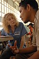 US Navy 081113-N-7544A-195 Project HOPE nurse practitioner Rachel Phillips, embarked aboard the amphibious assault ship USS Kearsarge (LHD 3), listens to a patient during a medical examination at the Mabaruma medical site.jpg