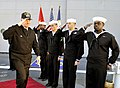 US Navy 090109-N-8273J-152 Chief of Naval Operations (CNO) Adm. Gary Roughead salutes as he is piped ashore.jpg