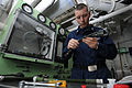 US Navy 090513-N-3946H-107 PACIFIC OCEAN (May 13, 2009) Aircrew Survival Equipmentman 2nd Class James Shoemaker inspects oxygen regulator hoses prior to a pressure decay test.jpg