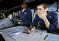 US Navy 090523-N-5345W-336 Quartermaster 3rd Class Devin Harrington, right, plots the course of the amphibious dock landing ship USS Fort McHenry (LSD 43) on a nautical chart in the pilothouse during an underway replenishment.jpg