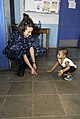 US Navy 090711-F-7923S-188 Hospital Corpsman 2nd Class Beatrice Russell, a medical operations tracker embarked aboard the Military Sealift Command hospital ship USNS Comfort (T-AH 20), plays with a young Nicaraguan boy.jpg