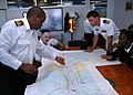 US Navy 090713-N-1655H-129 Durban Harbour Master Rufus Lekala, left, discusses the layout of local channels with Capt. Jim Tranoris.jpg
