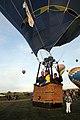 US Navy 091010-N-3750S-105 Blair Kaufman, center, guides his hot air balloon, Sun Dagger, off the ground at a sunrise mass hot air balloon ascension during the Albuquerque International Balloon Fiesta.jpg