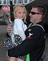 US Navy 091021-N-9860Y-006 Aviation Structural Mechanic (Safety Equipment) 2nd Class Brett Bingham hugs his daughter during the squadron's homecoming to the Naval Air Station Whidbey Island.jpg
