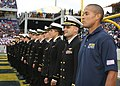 US Navy 091030-N-5366K-174 Special Warfare Operator 1st Class (SEAL) David Goggins stands at attention with members of the U.S. Naval Academy's triathlon team as they are recognized as Collegiate National Champions at the Navy.jpg