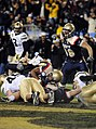 US Navy 091212-N-9693M-582 Navy quarterback Ricky Dobbs (^4) scores a touchdown on a 1-yard run in the fourth quarter of the 110th Army-Navy college football game at Lincoln Financial Field in Philadelphia.jpg