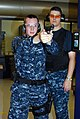 US Navy 100109-N-7042K-049 Recruit Training Command firearms instructors fire a 9mm handgun simulator at the USS Missouri Small Arms Marksmanship Trainer.jpg