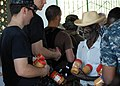 US Navy 100210-N-4971L-093 Engineman Fireman Recruit Patrick Shannon, from King's Mountain, N.C., assigned to the amphibious dock landing ship USS Fort McHenry (LSD 43), distributes peanut butter to Haitians in Birey, Haiti.jpg