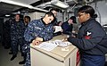 US Navy 100303-N-6003P-008 Personnel Specialist 2nd Class Audrea Hardy, from Pittsburgh, Pa, assists Sailors update their Page 2 sheets prior to their upcoming deployment.jpg