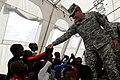 US Navy 100303-N-6278K-249 U.S. Army Lt. Gen. Ken Keen visits an internally displace person camp in Port-au-Prince, Haiti.jpg