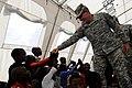 US Navy 100303-N-6278K-249 U.S. Army Lt. Gen. Ken Keen visits an internally displace person camp in Port-au-Prince, Haiti.jpg