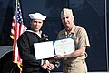 US Navy 100318-N-6936D-024 Rear Adm. Tim Alexander, commander of Navy Region Southeast, presents the Bronze Star medal to Explosive Ordnance Disposal Technician 1st Class Jason Miller.jpg