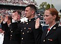 US Navy 100528-N-3857R-230 Marine Corps graduates from the U.S. Naval Academy Class of 2010 raise their right hands to take the oath of office during their graduation and commissioning ceremony.jpg