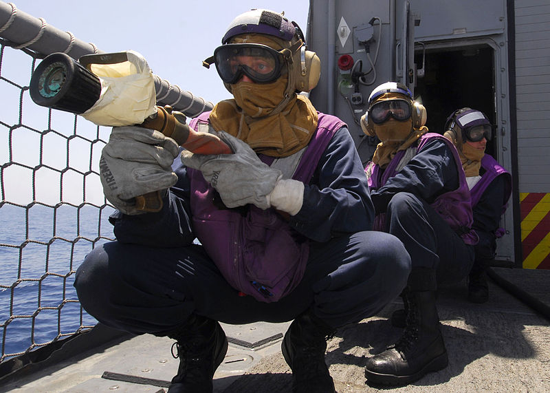 File:US Navy 100619-N-7638K-121 Sailors simulate the cooling of exploded ordnance from a helicopter crash during damage control training aboard USS Taylor (FFG 50).jpg