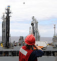 US Navy 100623-N-7058E-119 Chief Fire Controlman Michelle Fox, assigned to the littoral combat ship USS Freedom (LCS 1), fires a shot line to the military sealift command fleet replenishment oiler USNS Guadalupe (T-AO 200) duri.jpg