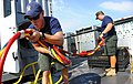 US Navy 100712-N-9769P-353 Navy Diver 1st Class Joel Sharp, left, assigned to Mobile Diving and Salvage Unit (MDSU) 2.jpg