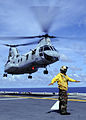 US Navy 100919-N-9950J-450 Aviation Boatswain's Mate (Handling) Airman Bernard Ugalde directs the lift off of a CH-46E Sea Knight helicopter aboard.jpg