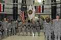 US Navy 101013-A-5402D-019 Members of a Navy honor guard parade the colors during a celebration of the Navy's 235th birthday at Al Faw Palace.jpg
