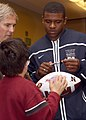 US Navy 101221-N-7065D-001 U.S. Naval Academy quarterback Ricky Dobbs signs an autograph for a child at a Make-A-Wish Foundation.jpg