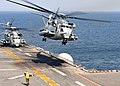 US Navy 110329-N-5538K-240 A CH-53E Sea Stallion helicopter takes off from the forward-deployed amphibious assault ship USS Essex (LHD 2).jpg