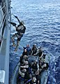 US Navy 110424-N-NL541-465 The visit, board, search and seizure team assigned to the guided-missile destroyer USS Nitze (DDG 94) boards the guided.jpg