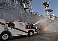 US Navy 110723-N-KA046-014 Sailors use a P25 fire truck to wash down the superstructure of the multipurpose amphibious assault ship USS Bataan (LHD.jpg