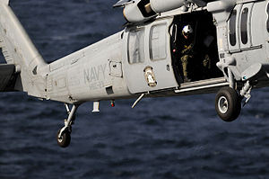 US Navy 120214-N-UT411-230 A Naval air crewman assigned to Helicopter Sea Combat Squadron (HSC) 23 guides the pilots of an MH-60S Sea Hawk helicopt.jpg