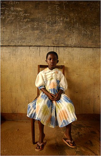 Navy Office of Community Outreach - A young Ghanaian girl wears her finest clothes as she waits to see American doctors from Navy Fleet Hospital Minneapolis
