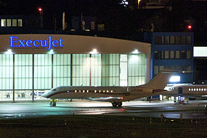 ExecuJet Aviation Group - Global Express in front of an ExecuJet building