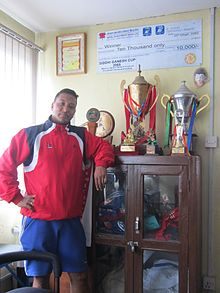 Upendra Man Singh with Awards.JPG