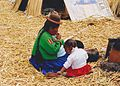 Uros Indian woman and little daughter on a cane island in the lake titicaca in Peru.jpg