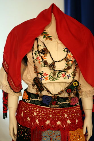 Traditional clothing of Kosovo - Young women's apparel. The floral embroidery symbolizes vitality and youth.