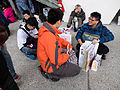 Visitors Sitting on Ground Sharing Collection after Event 20150131.jpg