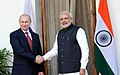 Vladimir Putin and Narendra Modi greet each other at the 15th Annual India-Russia Summit.jpg
