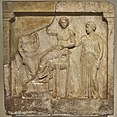 Votive relief with Apollo, Leto and Artemis (5th cent. B.C.) at the National Archaeological Museum of Athens on 4 July 2018.jpg