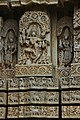 Wall relief sculpture with frieze on moldings at Lakshminarayana Temple at Hosaholalu.jpg