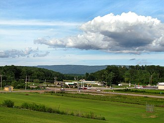 Tennessee State Route 28 - View looking east across the intersection of Tennessee State Route 28 and Tennessee State Route 283 in Whitwell. The Cumberland Plateau's Walden Ridge section is in the distant background.