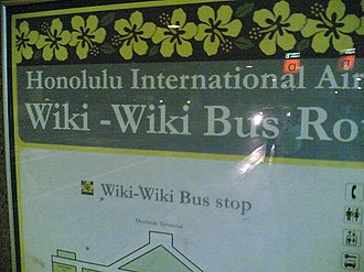 "Wiki Wiki Shuttle - ""Wiki-Wiki Bus stop"" sign at Honolulu International Airport, Hawaii, in 2001"