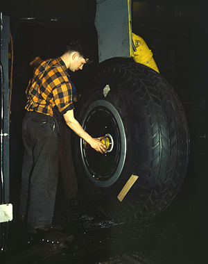 Willow Run - Inspection of the landing gear of a transport plane at Willow Run