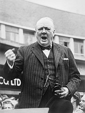 Churchill in mid-speech, his tight hand held in rhetorical pose