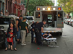 Emergency - Emergency Medical Technician  treating a woman who has collapsed in the street in New York. Dangers to life and health are serious enough that emergency response systems are considered vital.