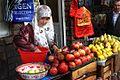 Woman selling fruit in Tajikistan.jpg