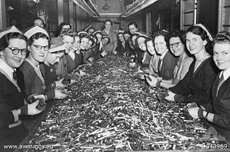 Small Arms Ammunition Factory - Women bundling ammunition in a Commonwealth Small Arms Ammunition Factory, c. 1944
